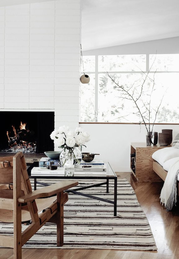Fireplace Makeover Painting the Brick Fireplace White - Amber Interiors