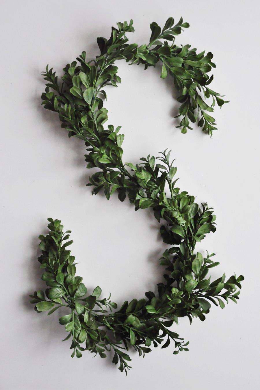 DIY: Modern, Asymmetrical Holiday Wreath on a Round Mirror