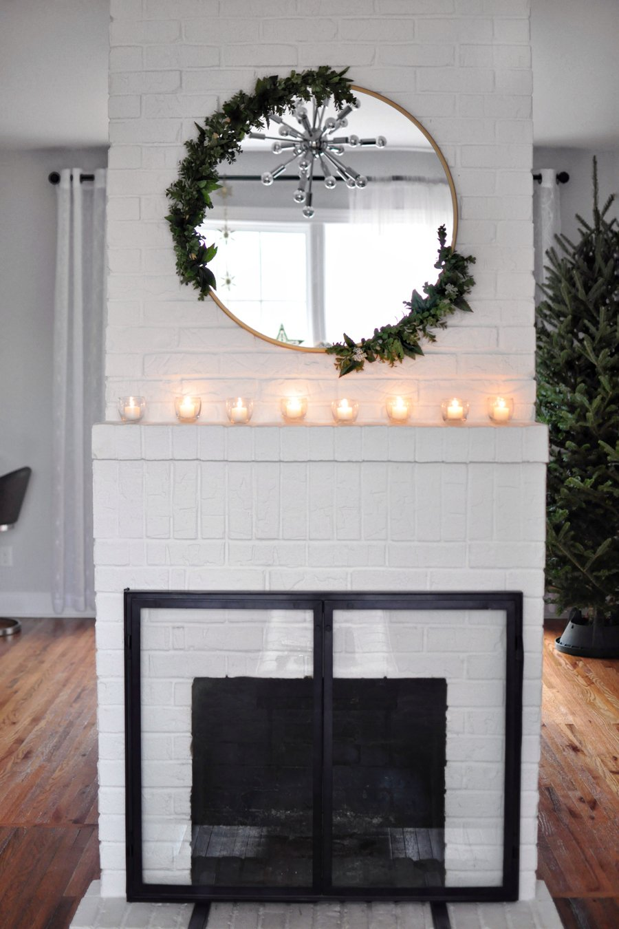 Diy Modern Asymmetrical Holiday Wreath On A Round Mirror